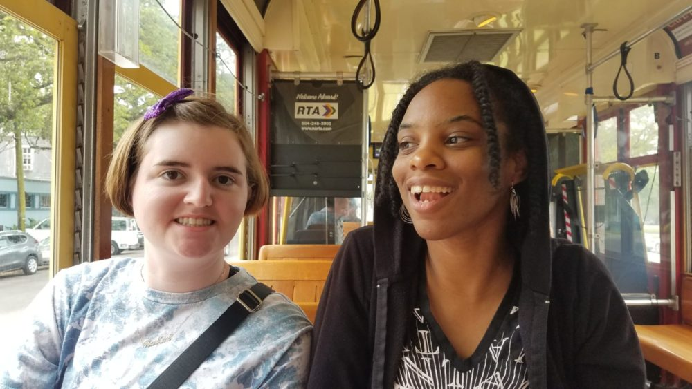 Guild members sit together on the New Orleans streetcar