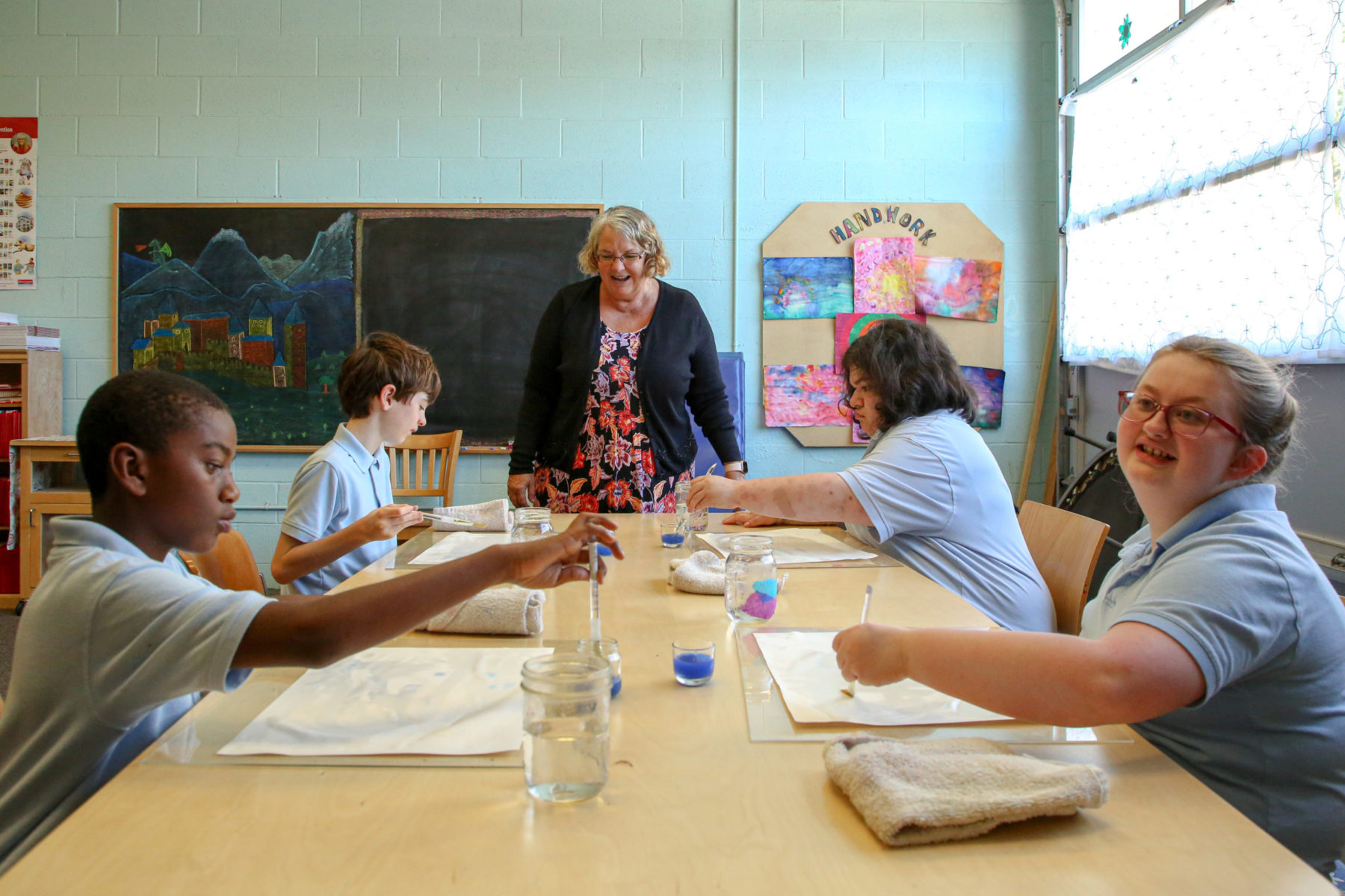 Raphael Academy students paint together